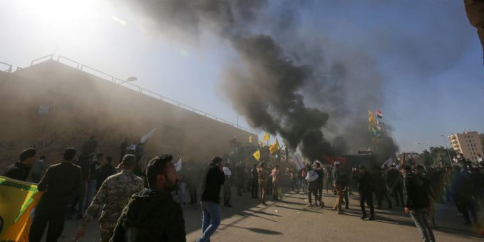 Protesters stormed the US embassy in Baghdad and torched parts of it on New Year's Eve – Business Insider